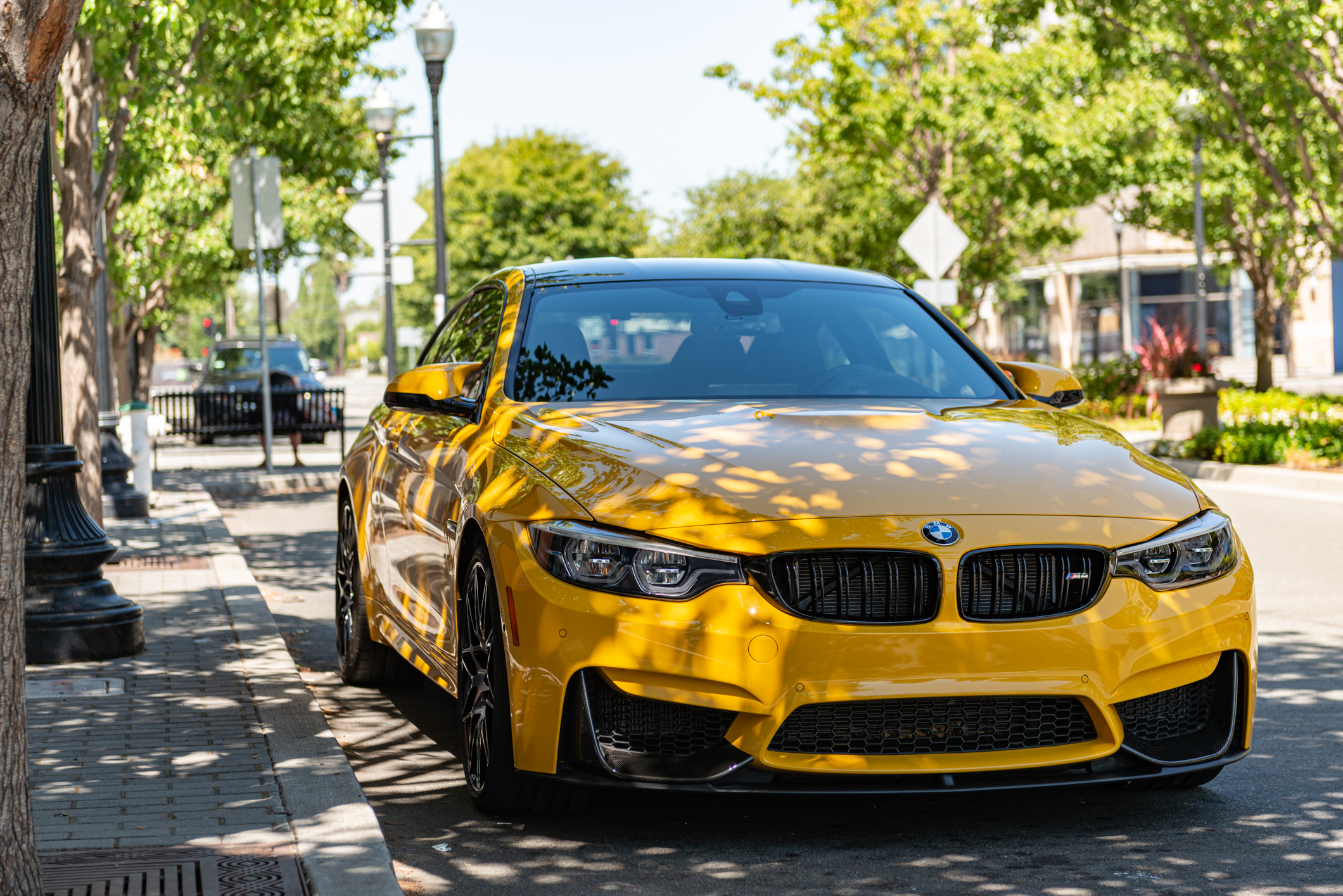 Photo of yellow BMW M4 in the shade